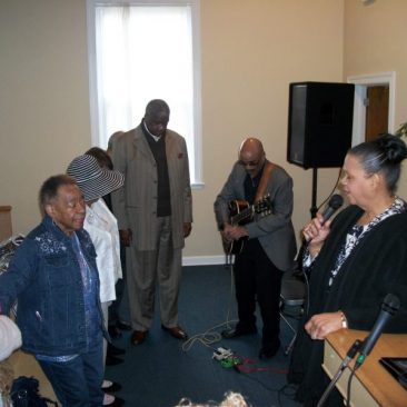 Co-Pastor Rev. Berta Newsome-Jones singing at Living Stones Ministries and Worship Center