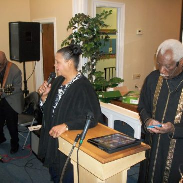 Pastor and Co-Pastor leading congregation at Living Stones Ministries and Worship Center