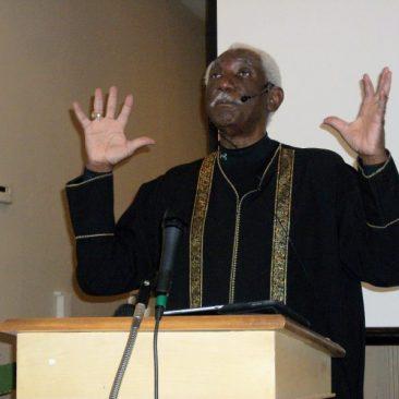 Pastor Apostle Rev. Dr. Cheviene Jones preaching